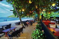 Thong Nai Pan Yai Beach, Koh Phangan, Thailand; many resorts here have restaurants right in the sand, shaded by big trees.