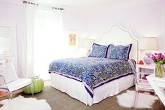 Sam Allen - Beautiful girl's room features lilac walls framing white studded headboard on queen bed dressed in pink and navy mosaic tiled bedding flanked by West Elm Parsons End Tables topped with lilac double gourd lamps.