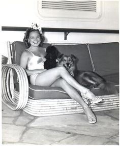 Sonja Henie with her dogs. Can not get over how much mymomAunt looked like her!!! She was always told she looked just like Sonja!