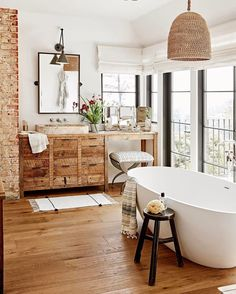 "13.7k Likes, 77 Comments - Roomporn (@roomporn) on Instagram: ""Warm bathroom uses a mix of exposed brick, wicker and natural wood in this home in Hollywood Hills,…"""