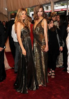 Angela Lindvall and Karlie Kloss: Angela Lindvall and Karlie Kloss walked the 2011 Met Gala red carpet together in gold metallic gowns — Angela wore Andrew Gn, while Karlie shone in Christian Dior.