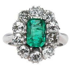 Columbian Emerald Engagement Ring with Sparkling Old Mine Cut Diamond Halo | From a unique collection of vintage engagement rings at https://www.1stdibs.com/jewelry/rings/engagement-rings/