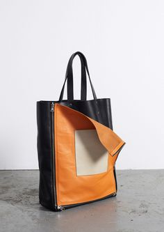 Zips make this bag multifunctional, the front panel can be detached giving the bag two different appearances.