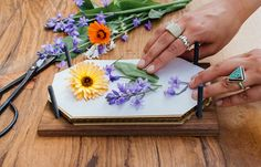 Did you know you can easily press flowers to preserve the color and beauty of spring? Here's step by step instructions for how to press flowers.