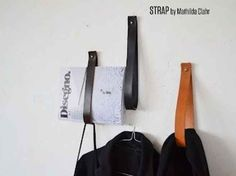 Leather strips for hanging stuff in the walls. Clever!