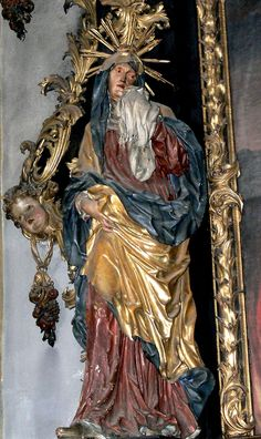 A statue of Mary weeping for the poor souls in purgatory in the church of St Wolfgang in Mondsee, Austria.