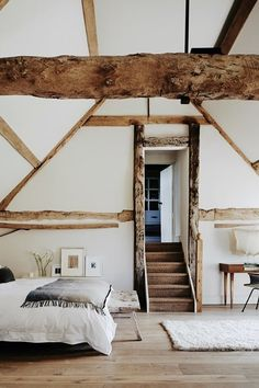 Minimal and chic bedroom designed by Joanna Vestey #interiordesign #interiorstyle #decor #minimal #modern #beams #bedroom #retreat