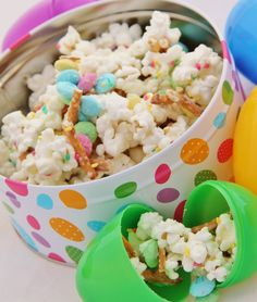 Bunny Bait--Sweet and Salty Spring Mix  1 bag popcorn, popped (non-buttery type is best)   7 oz. almond bark   1 bag Easter M&Ms   pretzel sticks, broken into small pieces   colorful sprinkles, if desired