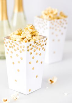 New Year's Ever Party idea - holiday party food - caramel popcorn in gold + white buckets {Courtesy of Brit + Co} Tags: Party ideas, NYE, New Year's Party, Party decorations, Gold Party, Nye Party, Oscar Party, Sparkle Party, Elmo Party, Mickey Party, Dinosaur Party, New Year's Eve Party Themes, New Years Eve Party Ideas Decorations