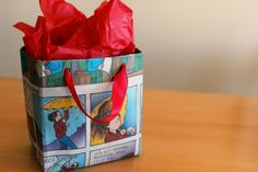 How to make a gift bag from newspaper (or Christmas wrap). 2 sheets, glue, card stock, ribbon.... that's it. Pattern on site.