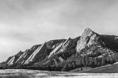 Sunrise Photography of the Flatirons on the edge of the foothills near the city of Boulder, Colorado. These iconic rock formations are a popular hiking/climbing destination and a symbol of Boulder and Colorado's Front Range. This photo was taken on a cool Thanksgiving morning - Fine art photography prints by Aaron Spong.
