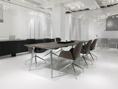 Ultra Modern Retro White Meeting Table features wood legs with white top. Great for executive offices, meeting rooms and for residential installations. Pollution Prevention, Davis Furniture, Meeting Table, Contract Furniture, Modern Retro, Industrial Furniture, Photo Library, Armchair, Dining Table