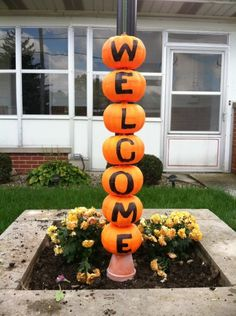 pumpkin welcome sign made with dollar store foam pumpkins, featured on DollarStoreCrafts.com