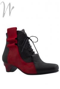 #Black leather ankle #boot with a wave of #red leather on the side, and red heels. Zip to inside. Removable leather insoles. Beautiful eye catching boot and so very comfortable.