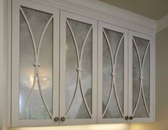 Designer Crystal Reeves had the Cavanaghs' cabinet doors covered with antiqued mirror that looks like mercury glass. It gives Pat Cavanagh space to store her work without making the landing look messy.
