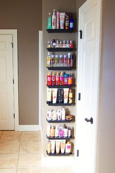 Easy DIY Bathroom Organization! Use crown molding to make shelves to organize perfumes, lotions, hairspray, etc. Neat, organized, and right ...