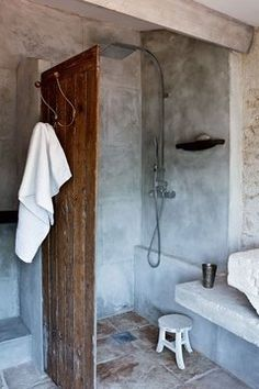 Great curbless shower/wet room idea! Use an old door or some other separation material. Stylish and cost effective.