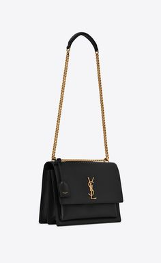 Saint Laurent monogram bag with front flap, featuring side gussets, a leather shoulder strap, leather-encased key ring and metal YSL initials. Fall Handbags, Kate Spade Handbags, Fashion Handbags, Tote Handbags, Purses And Handbags, Fashion Bags, Cheap Handbags, Popular Handbags, Handbags Online