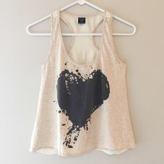 Graphic Tank Cute and casual tank top with splatter painted heart design. In like new condition, no holes, stains or imperfections. Comes from a smoke free environment. Bundles welcome Offers welcome through offer button. ❌NO trades, please. ⚡️Same/Next day shipping Tops Tank Tops