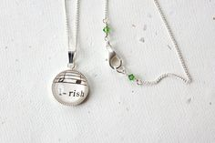 Irish pride necklace made with vintage sheet music