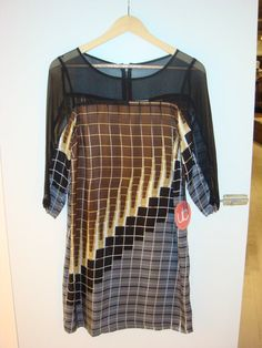 A sheer shift dress that paired with tights and a cami dress (yes, we have both!), can go from day to night!