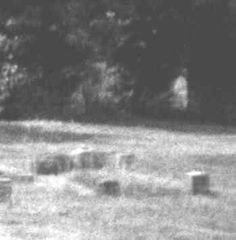 This photo was taken in the graveyard of Borley Rectory. It seems to show a ghostly figure in the trees.