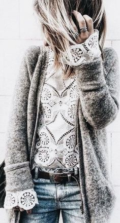 Gray cardigan over print top with blue jeans.