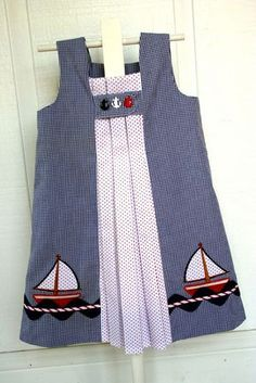 """Sailboat applique dress    Pattern I used to make this is """"Birthday Party Dress"""" by Oliver + S. Both fabrics are by Fabric Finders. Embroidery applique design is from www.emblibrary.com  Materials to make this dres are available from www.sewblessedfabric.com (email the shop for a kit)"""