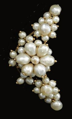 NATURAL PEARL BROOCH, LATE 18TH CENTURY Designed as a floral spray set with natural pearls of various shapes, accompanied by a handwritten note from the Duchess Adelgunde of Modena (1823-1914), stating that this pearl brooch was once in the possession of Empress Maria Theresa.