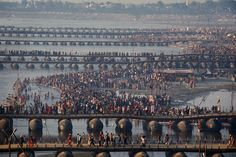 Hindu devotees gather on the shores of the River Ganges as it meets the Yamuna river in Allahabad on February 9, 2013 during the Kumbh Mela, which sees up to 100 million worshippers gather over 55 days to take a ritual bath in the holy waters. (Roberto Schmidt/AFP/Getty Images)