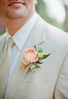 coral ranunculus boutonniere. Josh and I really like the style of this ranunculus boutonnière especially if we use a solid red ranunculus