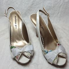 "NWOT Slingback Open Toe Pumps Perfect for Spring or Easter, these Madden girl white slingback open toe pumps have such a pretty floral pattern. Faux wood platform and heel. Never worn. Bow on right shoe has a small defect (see last pic). 4"" heel, 1/2"" platform. Steve Madden Shoes Heels"
