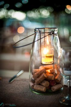 Glass lantern jar filled with wine corks and small candle. Perfect for table center pieces are hanging decorations. #Peltzerwineryandfarm, #peltzerwedding, #temeculawedding
