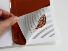 How About Orange - first laser print - then transfer foil with an iron - I have to try this.