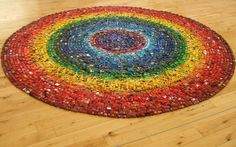 Artist, David Walker, spent eight hours arranging his collection of 6,000 toy cars to create a circular rainbow
