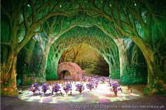 LOVE this stage scenery... Rolled cardboard and paper trees could recreate something like this...and then some pine trees, snow on the bridge and lots of ribbons, lanterns and poinsettias could turn it into a Christmas setting