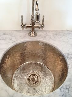 hammered metal sink basin... Would look good in butlers pantry with the shiny ceiling