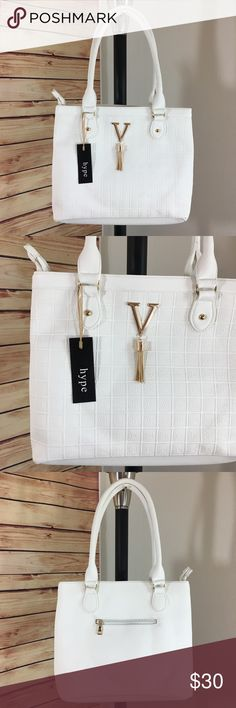 "🎁 NEW white tassel handbag / purse ✨Brand new handbag / purse✨Only 1 of this color and style available✨ -Color: white handbag with gold hardware, different lighting varies color (see last picture for bag being modeled in natural light) -Dimensions: 15.5"" length, 11.5"" height, 5"" width, 10"" strap drop, can be worn as shoulder length -Details: bag is split into 2 zippered sections, 2 interior pouches, 1 interior & 1 exterior zippered pocket -Materials: soft animal friendly VEGAN LEATHER, easy…"
