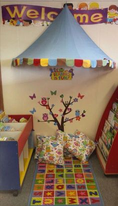 I love the tree, the owls and the welcome sign in this reading corner! The canopy on the ceiling looks like a circus tent! Reading Corner Classroom, Classroom Layout, Classroom Organisation, Classroom Setting, Classroom Design, Classroom Displays, Classroom Themes, Reading Corner Kids, Reading Nook