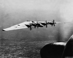 1946  A U.S. Army Air Force XB-35 flies over Los Angeles.