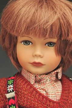 """Close-up detail of 20"""" Maurus doll, cloth-bodied with attached vinyl limbs and head, Switzerland, 1986, by Heidi Ott."""