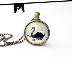 Handmade pendant necklace with an original tiny painting under glass.   This is ink and watercolor on paper hand painted swan. Black swan - symbol of beauty, elegance and power.  The original painting closed under glass and set in brass. TotemSwan artistic jewelry.