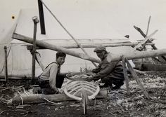 Man and youth (Eskimo) building kayak, 1929? – 1943? by Marquette ...