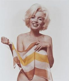 More #Border markings from Bert Stern (b. 1929). Marilyn Monroe with Orange and Yellow Striped Scarf (from the Last Sitting), 1962. Chromogenic print, printed 1982 on Agfacolor paper, signed in black ink with photographer's stamp and date verso, 35.5 x 30.4cm (14 x 12in)