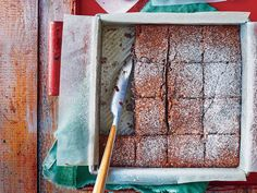 Fudge Cake Recipe | This indulgent yet totally portable dessert is everything you want in a make-and-take cake. The recipe is excerpted from entertaining expert Elizabeth Heiskell's cookbook What Can I Bring? Elizabeth says that when her mother talks about this fudgy dessert, her eyes glaze over. The cake was sold at the Lowry Motor Court restaurant in Greenville, Mississippi. Mama said they displayed it by the register under a glass dome, and each perfectly square slice was neatly wrapped…