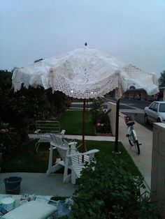 doilie and lace and ruffled umbrella for outside beauty & Take the canvas cover off of a patio umbrella then sew together 3 ...
