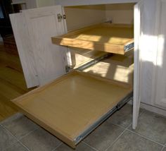 The RunnerDuck Spice Rack plan, is step by step instructions on how to build a sliding shelf for a kitchen cupboard.