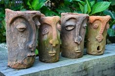 Four Face Plant Pots--an interesting idea for a clay project?