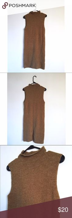 """FO21 Brown Knit Turtleneck Sleeveless Dress Tons of stretch all over. Light orangish brown wool-like dress. Not sure what the actual material is. High neck. No flaws. Neck is 2"""" high. Exposed hem in back of dress. Slit up back of dress as well.   Length: 36"""" Bust: 32"""" W/ Stretch Waist: 31"""" W/ Stretch Hips: 31"""" W/ Stretch Forever 21 Dresses Midi"""
