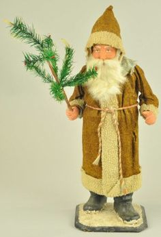 GERMAN SANTA CLAUS CANDY CONTAINER for auction. Santa wearing a brown felt robe and hood trimmed in white, rabbit fur beard on a composition head, very nice feather tree in one hand. The candy container has been replaced, (VG Cond. German Christmas, Antique Christmas, Christmas Past, Father Christmas, Christmas Items, Christmas Ornaments, Christmas Classics, Christmas Holidays, Primitive Santa